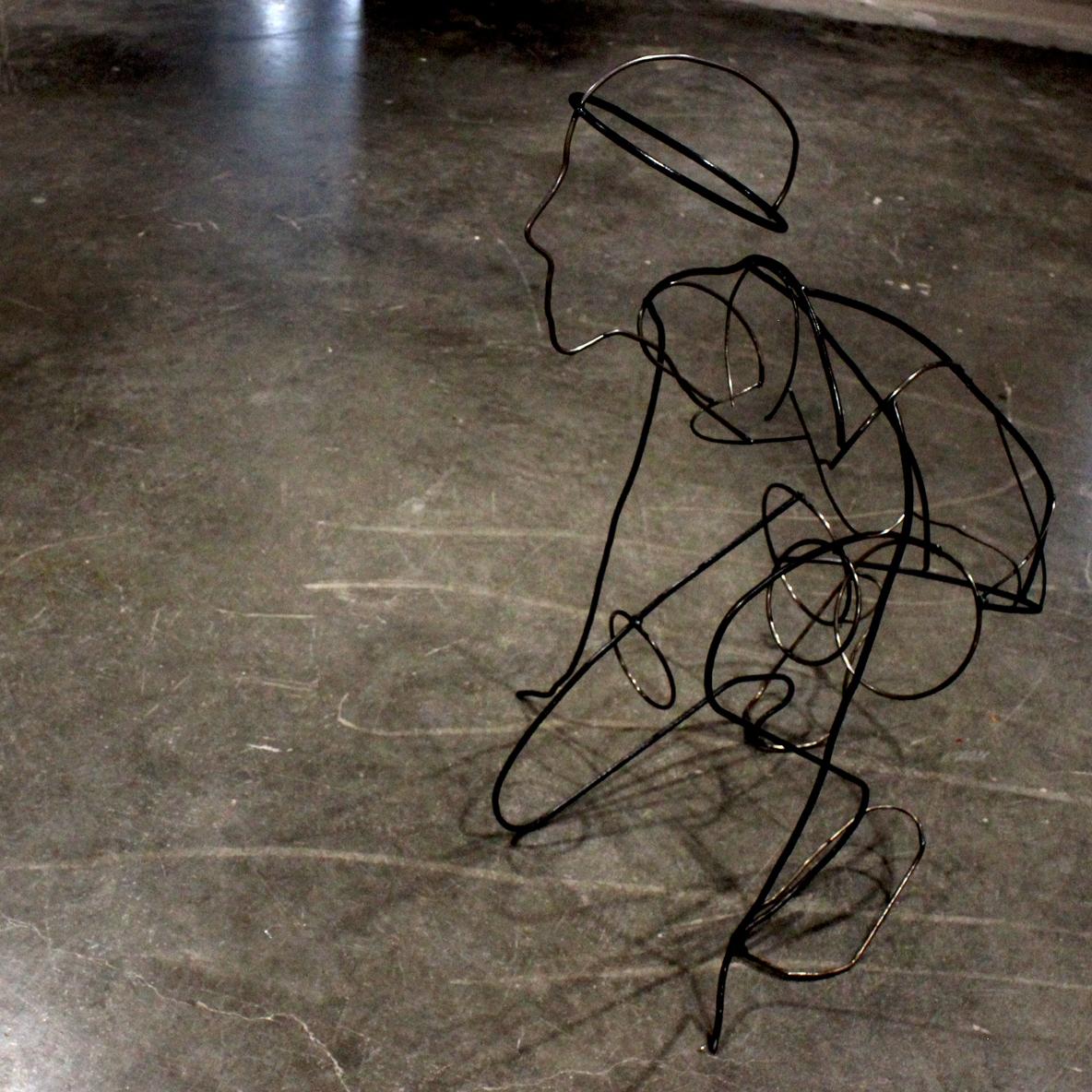 Iron sculpture of a human by Ada Denil 2019